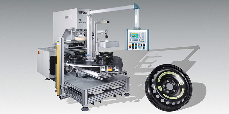 Pad printing machine for printing spare car wheels